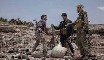 Fighters from a militia known as the Security Belt discuss launching a mortar toward Houthi rebels on the frontline in Yemen's Dhale province, August 5, 2019.