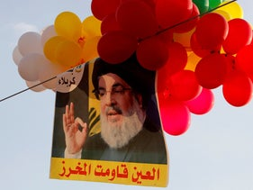 Balloons with a picture of Nasrallah hang in the air, in al-Ain village, Lebanon August 25, 2019.