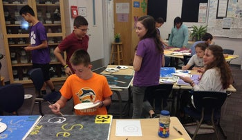 Students at Hershorin Schiff Community Day School in Sarasota, Fla. create panels for the periodic table of elements.