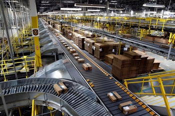 Packages ride on a conveyor system at an Amazon fulfillment center in Baltimore, United States, on August 3, 2017.
