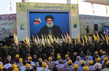 Hezbollah supporters gather to watch a speech by Hasan Nasrallah, in the town of Al-Ain in Lebanon's Bekaa valley, August 25, 2019.