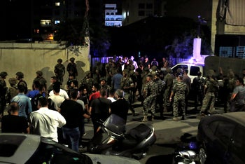 Lebanese security forces at the site where a drone fell in Beirut.