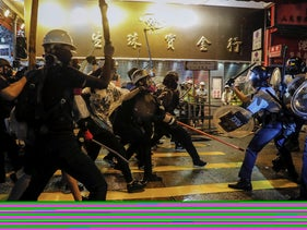 Policemen clash with demonstrators on a street during a protest in Hong Kong, August 25, 2019.