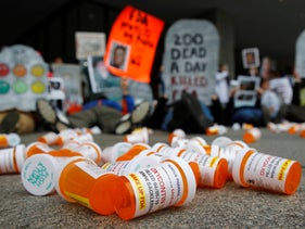 OxyContin prescription pill bottles lie on the ground in front of the Department of Health and Human Services' headquarters in Washington