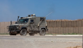 An Israeli army vehicle patrols the Gaza border, August 22, 2019.