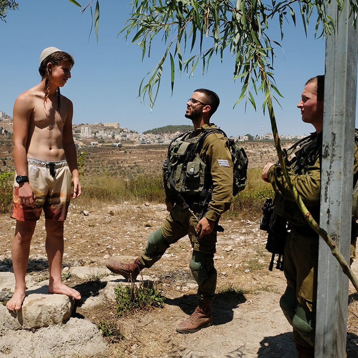 Soldiers at a West Bank spring. More than 60 such sites have been seized by settlers as part of a project of plunder there that began 10 years ago.