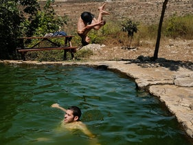"""A pool at the Anar Springs, formerly named Ein a-Shuna. Who's banned from such places, we ask a soldier. """"Arabs,"""" he says. """"This place is only for Jews."""""""