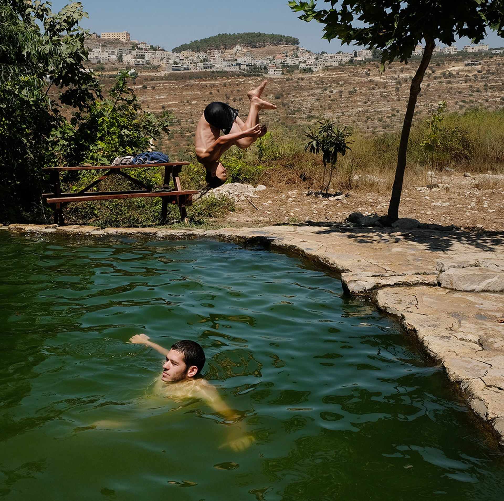 "A pool at the Anar Springs, formerly named Ein a-Shuna. Who's banned from such places, we ask a soldier. ""Arabs,"" he says. ""This place is only for Jews."""
