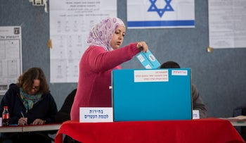A woman votes in Beit Safafa, March 18, 2015.