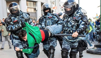 Police detain a man during a protest in Moscow, Russia, August 10, 2019.