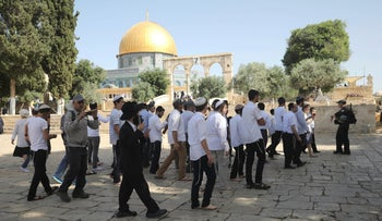 Israeli police officers escort a group of religious Jews near the Dome of the Rock Mosque on the Temple Mount in Jerusalem's old city, June 2, 2019.