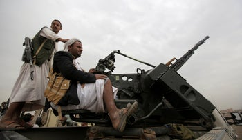 Houthi rebel fighters ride on a truck mounted with weapons in Sanaa, Yemen, Thursday, August 1, 2019