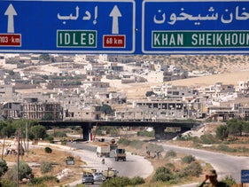 Road direction signs are pictured at the entrance en route to Khan Sheikhoun, Idlib, Syria August 24, 2019.