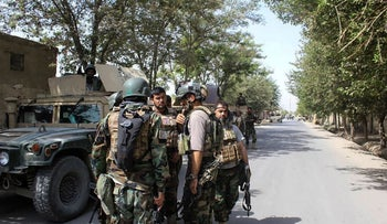 Afghan security forces gather at a street in Kunduz, Afghanistan, August 31, 2019.