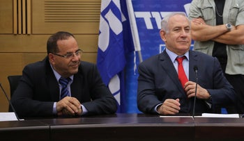 Netanyahu and Ayoub Kara at a Likud meeting, September 8, 2017.