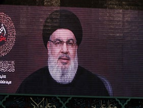 A speech by the Lebanese Shi'ite Hezbollah movement's leader Hassan Nasrallah is transmitted on a large screen in the Lebanese capital Beirut's southern suburbs on September 2, 2019