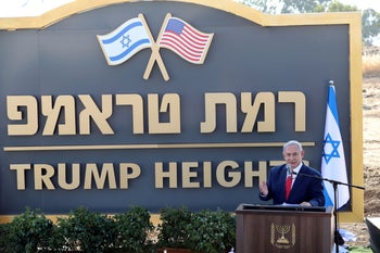 sraeli Prime Minister Benjamin Netanyahu speaking during a ceremony to unveil a sign for a new community named after U.S. President Donald Trump in the Golan Heights, June 16, 2019.