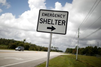 """An """"Emergency shelter"""" sign pointing to a local high school ahead of the arrival of Hurricane Dorian in St. Augustine, Florida, September 2, 2019."""