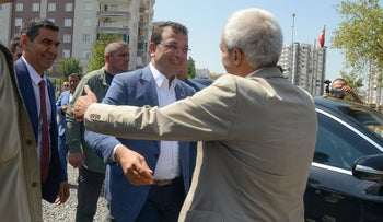 Ekrem Imamoglu hugs the removed mayor of Diyarbakir, Adnan Selcuk Mizrakli in Diyarbakir, August 31, 2019.