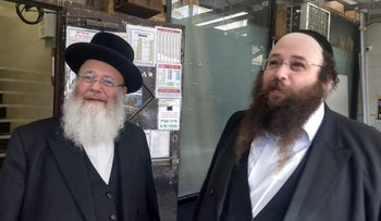 Yosef Rapaport, left, and his son Alexander do not feel that life has become more dangerous for Orthodox Jews in Brooklyn. They say attacks on Jews are nothing new.