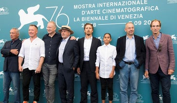 Actors Udo Kier, from left, Aleksei Kravchenko, Stellan Skarsgard, Barry Pepper, from fourth right Petr Kotlar, director Vaclav Marhoul and Julian Sands pose for photographers at the photo call for the film 'The Painted Bird' at the 76th edition of the Venice Film Festival in Venice, Italy, Tuesday, Sept. 3, 2019