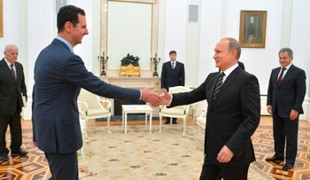 Russian President Vladimir Putin shaking hands with Syrian President Bashar Assad at the Kremlin in Moscow, October 20, 2015.
