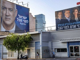 Kahol Lavan and Labor-Gesher campaign billboards pictured in August.