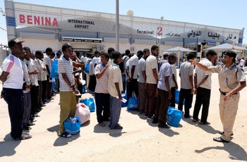 Sudanese refugees wait to be deported at LIbya's Benina Airport, August 8, 2019.