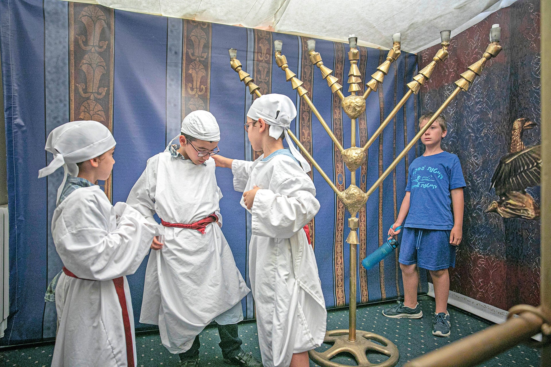 """Children wearing priestly attire, at a workshop at the Jewish Baking Center. White flour and games in the spirit of the Temple – like the """"Red Cow Labyrinth."""""""