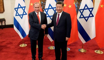 Chinese President Xi Jinping and Prime Minister Benjamin Netanyahu shake hands ahead of their talks at Diaoyutai State Guesthouse in Beijing, China March 21, 2017.