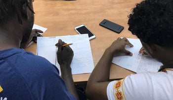 Asylum seekers taking notes during a lesson at The Schoolhouse in Tel Aviv, September 2019.