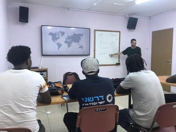 A teacher instructs students during a GED class at The Schoolhouse in Tel Aviv, September 2019.