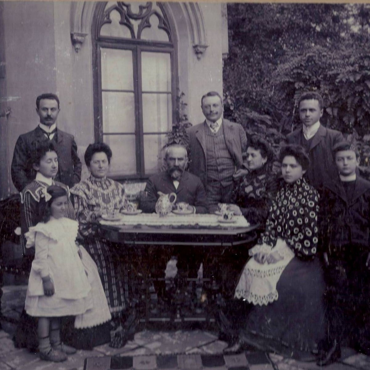 Izak Goldman, Blanka's grandfather, in the center at the Goldman Family home in Tarnów in an undated photograph. The house is now called Wedding Palace. The rest of the people are unknown.