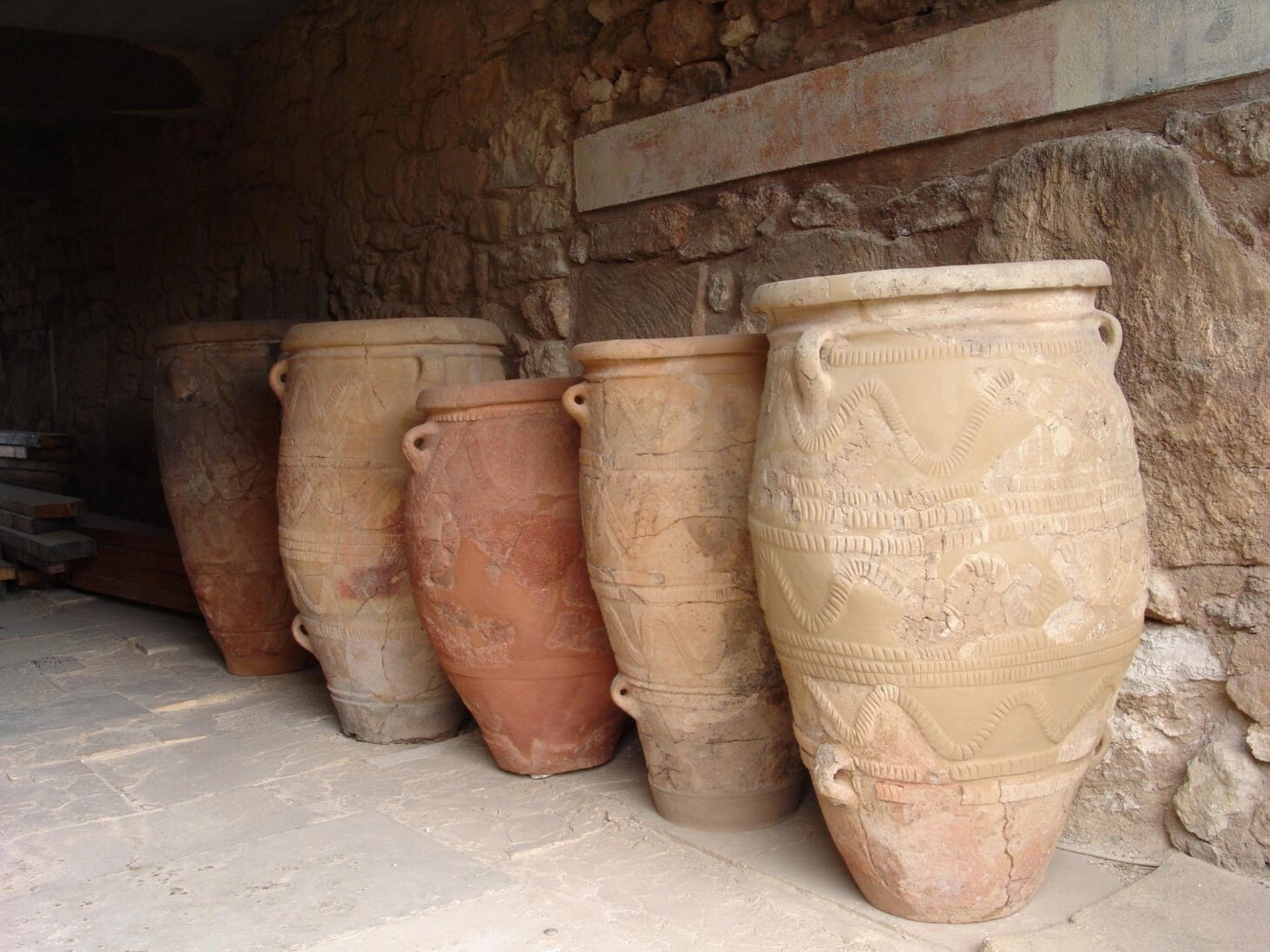 "Restored pithos (storage jars) from the West magazines at the palace of Knossos. The palace was both a royal residence and ""a great store"""