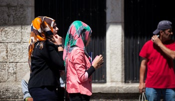 Women unrelated to the article wearing a headscarf.