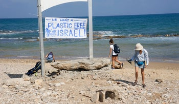 Volunteers clean Jaffa's beach from plastic.