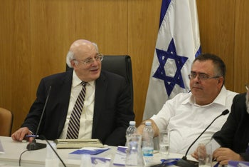 Elections Committee chairman Justice Hanan Melcer and Likud lawmaker David Bitan, Jerusalem, August, 2019.