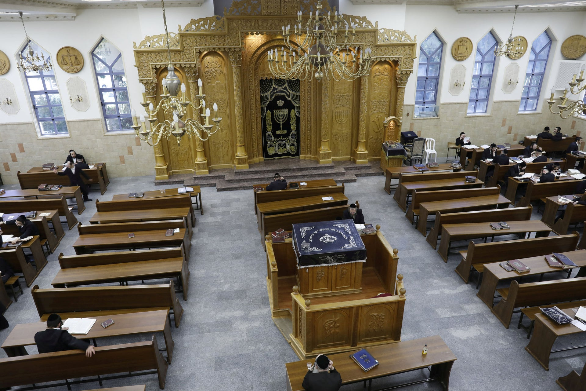 Ultra Orthodox Jewish men study inside a synagogue in the Israeli settlement of Beitar Illit