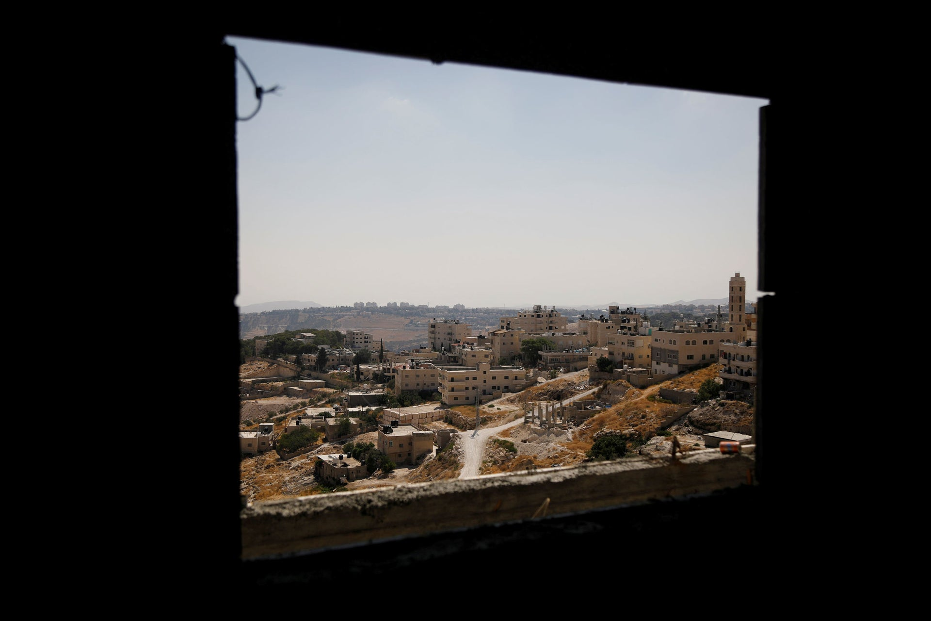 A view shows Palestinian houses in al-Eizariya village, close to the Jewish settlement of Maale Adumim