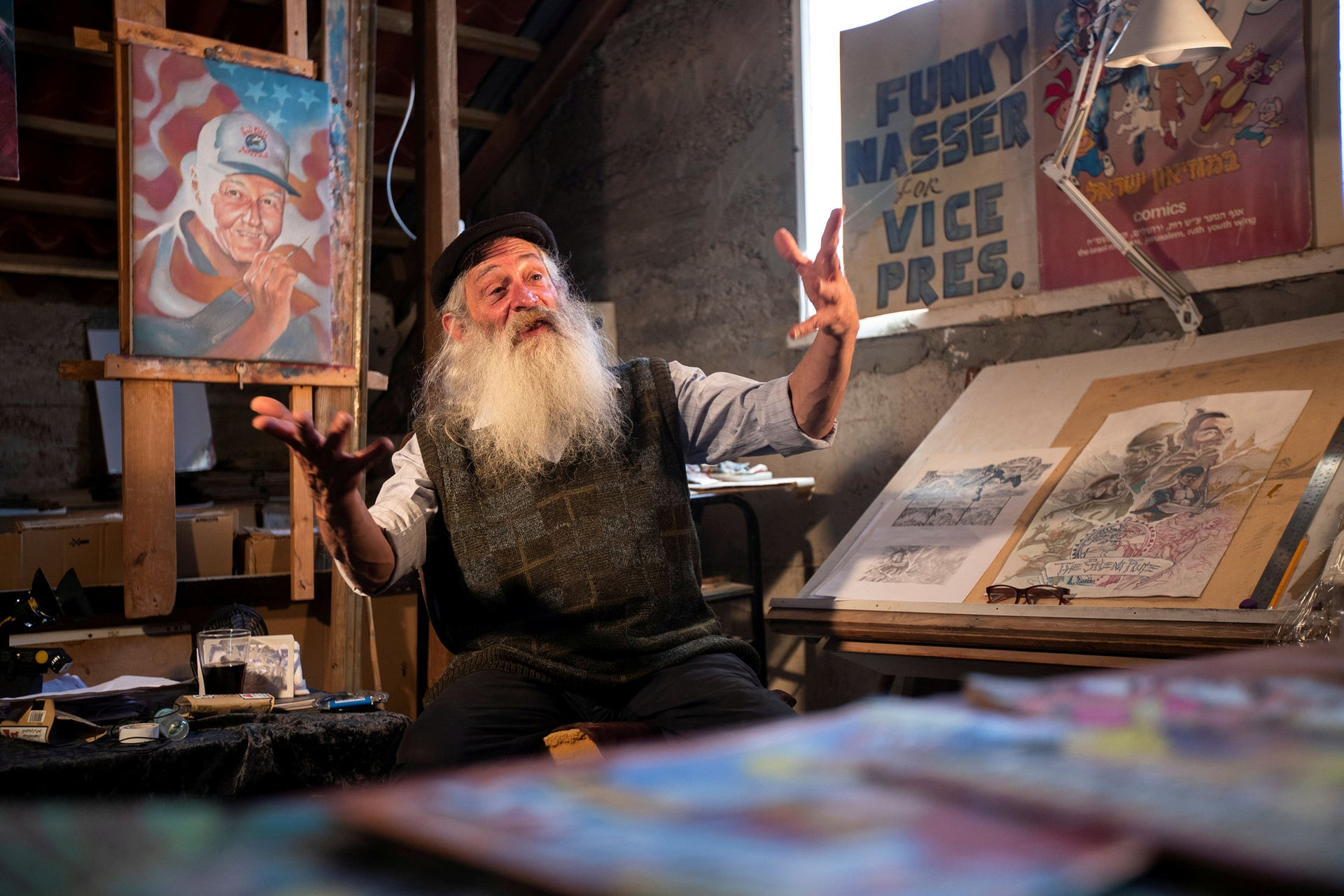 Michael Netzer, 63, an American comic artist formerly named Mike Nasser, in his attic studio at his home in the Israeli settlement of Ofra.