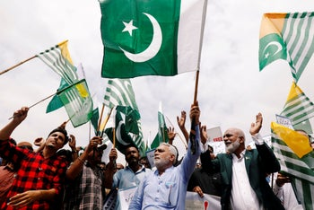 """People carrying Pakistani and Azad Kashmiri flags during a countrywide """"Kashmir Hour"""" to express solidarity with the people of Kashmir, Karachi, Pakistan August 30, 2019."""