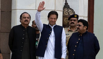 Pakistani Prime Minister Imran Khan, center, attending a Kashmir rally at the Prime Minister's Office in Islamabad, August 30, 2019.