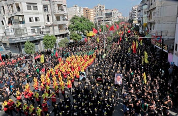 Supporters of Hezbollah march during a religious mourning procession of Ashura in Beirut, Lebanon, September 10, 2019.