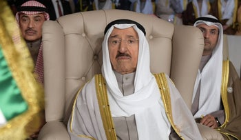 Kuwait's Emir Sheikh Sabah al-Ahmad al-Jaber al-Sabah (C) attends the opening session of the 30th Arab League summit in the Tunisian capital Tunis, arch 31, 2019.