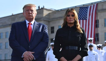 US President Donald Trump and First Lady Melania Trump observe a moment of silence during a ceremony marking the 18th anniversary of the 9/11 attacks, on September 11, 2019, at the Pentagon in Washington, DC.