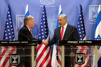 Prime Minister Benjamin Netanyahu shaking hands with then-National Security Adviser John Bolton as they deliver joint statements in Jerusalem, June 23, 2019.