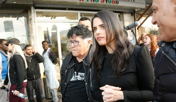 Ayelet Shaked tours south Tel Aviv with anti-migrant activist Sheffi Paz, April 2, 2019