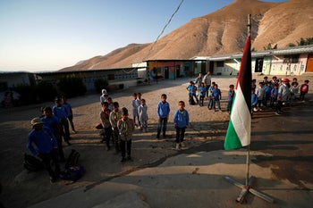 Palestinian students participate in a morning exercise at their school in Jordan Valley in the Israeli-occupied West Bank September 11, 2019.
