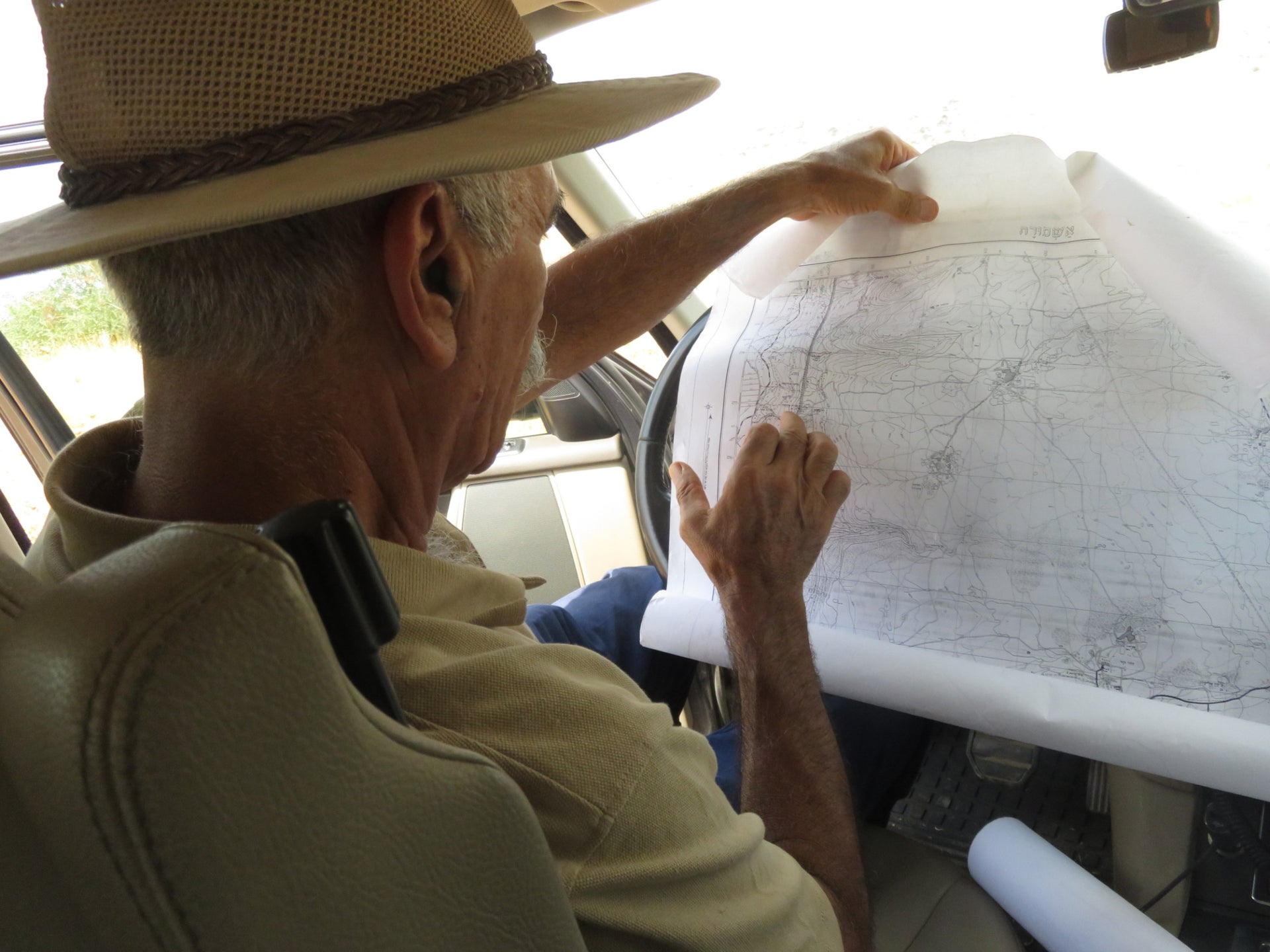 Morris Tzemach looking at a historic map of the area.