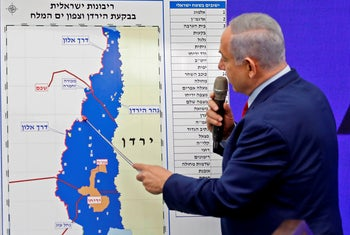 Israeli Prime Minister Benjamin Netanyahu points out the Jordan Valley, an area he has declared Israel will annex, as he gives a statement in Ramat Gan. September 10, 2019